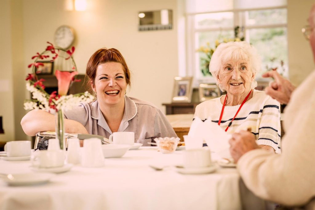 Carer with residents