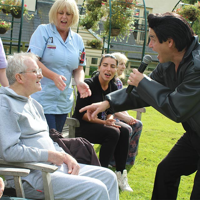 A singer entertaining residents at The New Deanery
