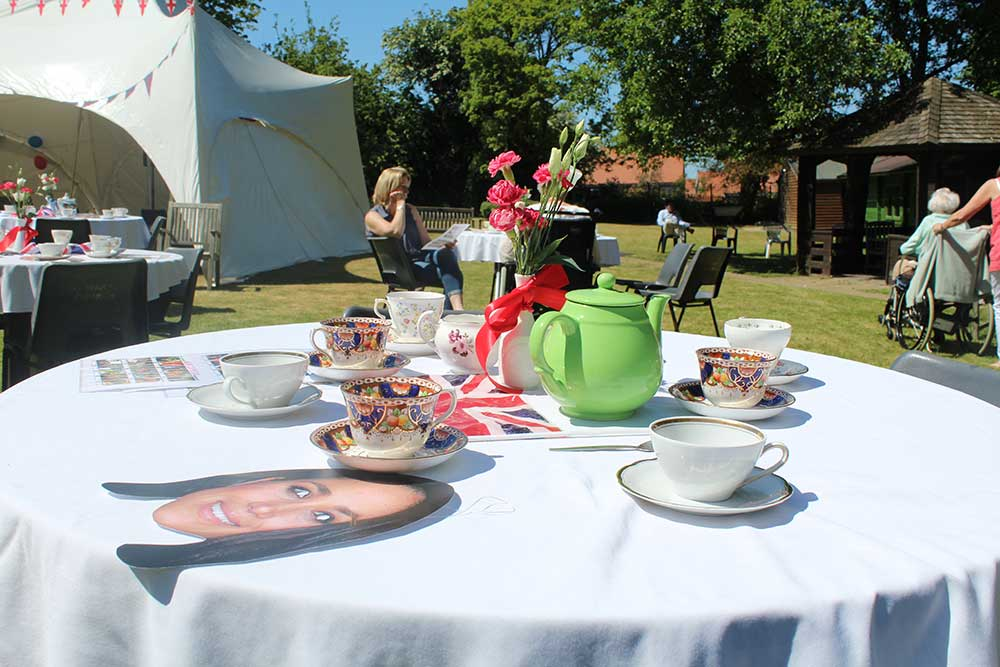 Afternoon tea enjoyed in the sunshine with Meghan and Harry masks